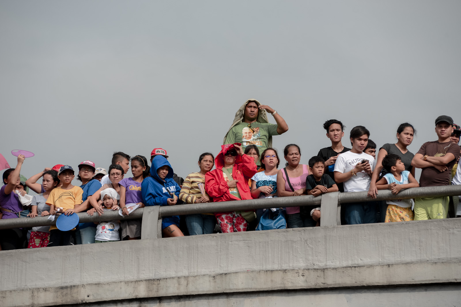 Thousands of Manila residents watch as Pope Francis enter the Malacanang compound, Friday, January 16, 2015. Pope Francis is in the Philippines for a five-day trip to the sole Catholic nation in Asia, on January 15 to 19, 2015. With 80% of its population Catholic, millions of faithfuls are expected to flock the streets hoping for a glimpse of the Pope.