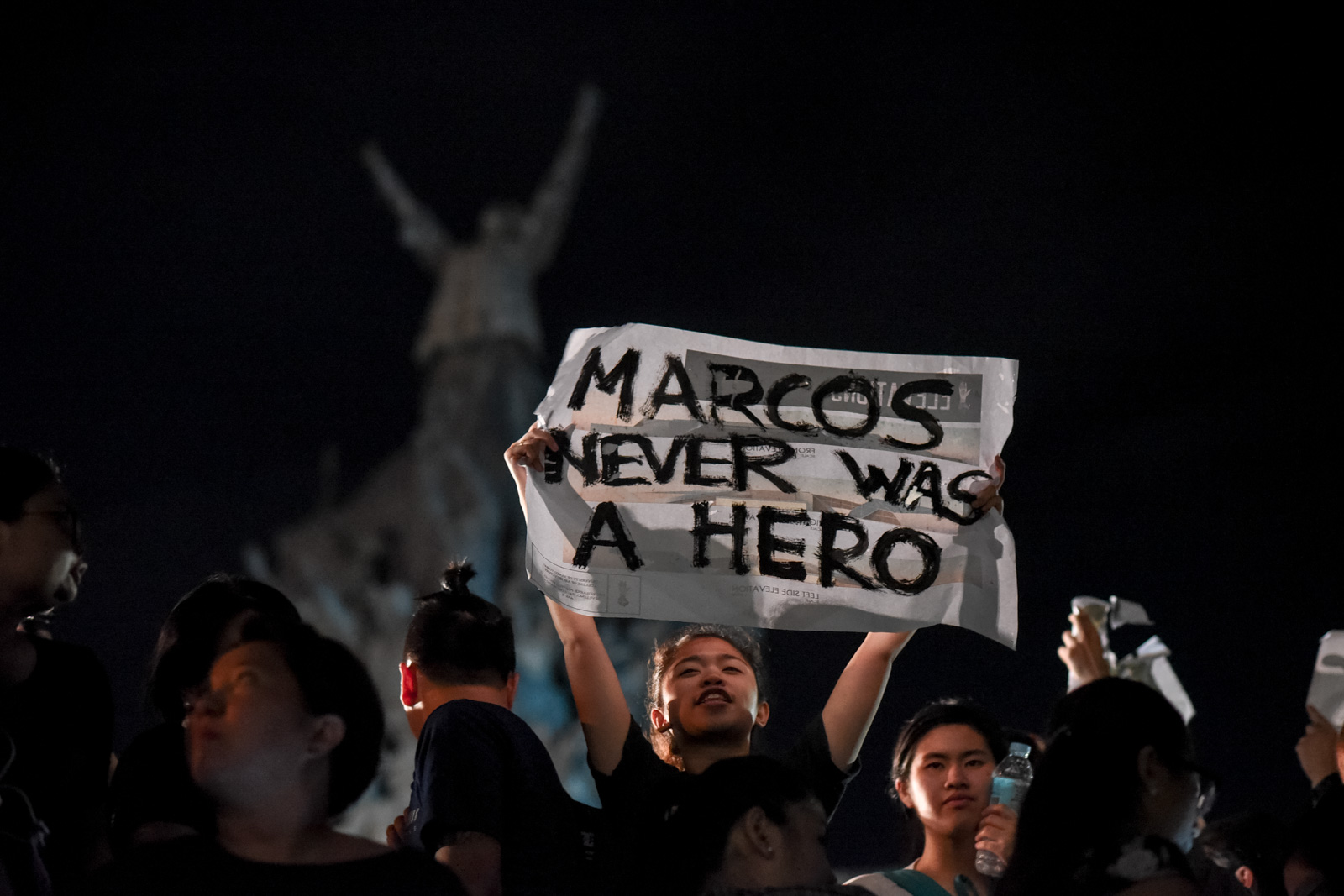 Thousands of Filipinos gather at the People Power Monument along EDSA voicing their dissent on Ferdinand Marcos' surprise burial at the Libingan ng mga Bayani, November 18, Quezon City, Philippines.
