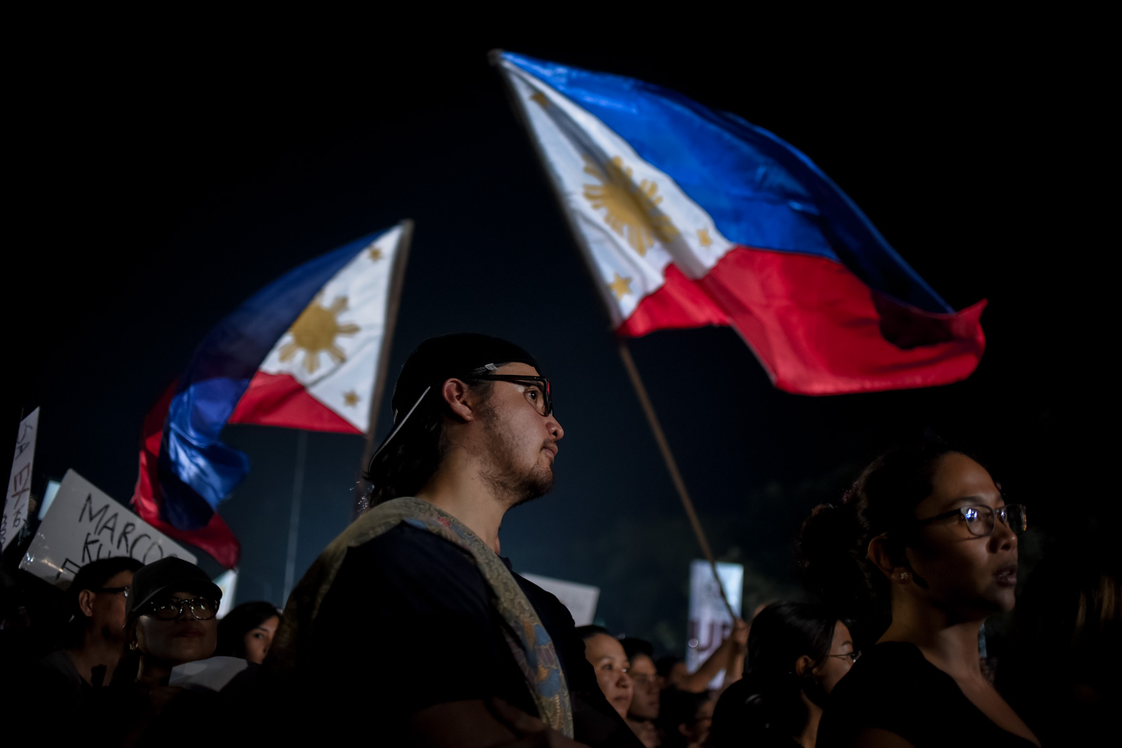 Thousands of Filipinos gathered at the People Power Monument along EDSA voicing their dissent on Ferdinand Marcos' surprise burial at the Libingan ng mga Bayani, November 30, Quezon City, Philippines.